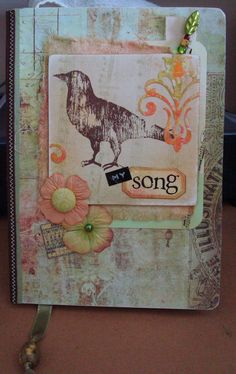 love love love this altered journal cover.