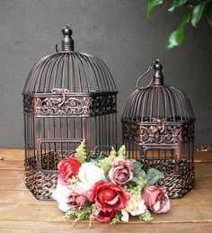 Bird cages are amazing for weddings instead of wishing wells. However they're also lovely with candles or a pot plant inside,