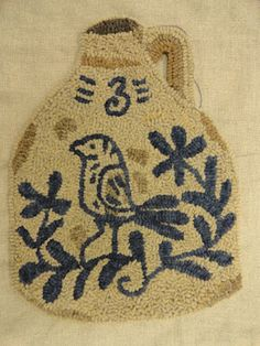 sorry, I don't know who hooked this beautiful jug rug.  edited to say, I've found out the hookers name is Karin.