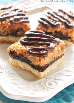 Samoa Brownie Bars - A shortbread crust topped with a brownie layer and caramel coconut inspired by the girl scout cookie.