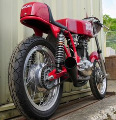 Ducati ………… red, of course!. Stunning late 60`s 250cc race single…