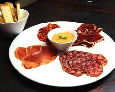 Variation spanish sausages iberico bellotta   chorizo, lomo, salsicham, jamon with tomato dip and toast