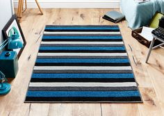 Viva Blue Striped Rug is a simple yet awesome way to decorate your flooring this summer...#bluerugs #stripedrugs #largerugs