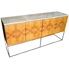 A 1970's burled bookmatched olive wood sideboard with Carrara marble top by Milo Baughman for Thayer Coggin | From a unique collection of antique and modern sideboards at http://www.1stdibs.com/furniture/storage-case-pieces/sideboards/