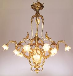 "A Very Fine and Large French Century Belle Époque Gilt-Bronze and Molded Glass Ten Light ""Lyre Style"" Chandelier with the Original Frosted Glass Flower Shades. The bronze stamped ""LH - 170 Circa: Paris, 1900 Antique Brass Chandelier, Murano Chandelier, Lantern Chandelier, Crystal Chandeliers, Antique Lighting, Chandelier Lighting, Fiat Lux, Fan Decoration, Glass Molds"