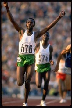 Olympic Champion Kipchoge Keino ~ the first great Kenyan distance runner, 3,000 meter steeplechase, Munich, July 1972  by John Dominus