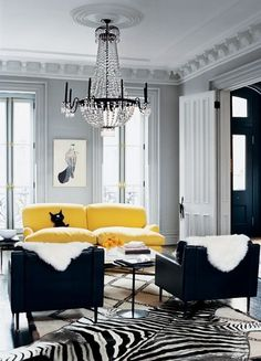 Black and White Room, Yellow Sofa for Accent, Chandelier -  but look at that black cat pillow !!