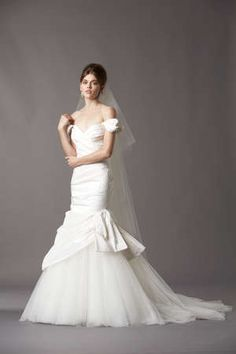 An incredible off the shoulder wedding dress made with silk taffeta and tulle.