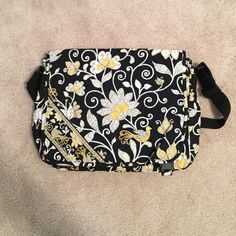 Vera Bradley messenger bag Vera Bradley messenger bag in Yellow Bird (retired pattern). Features adjustable shoulder/cross body strap, three outer pockets, and interior organization. Great bag for school! Only sign of wear is wrinkle/fold in bottom right corner of front flap (see last photo). Vera Bradley Bags