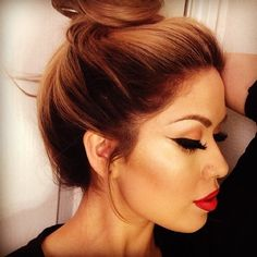 Red lips and winged eyeliner
