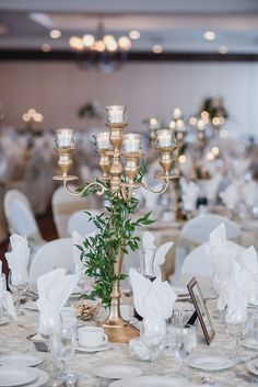 Peach, cream and Gold wedding color palette. Gold candelabra wrapped in greenery by Kari Dawson Photography