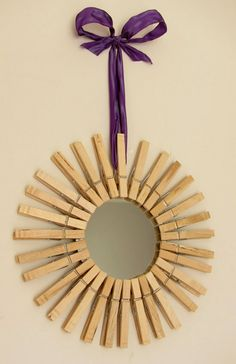 I have been wanting a sunburst mirror but they are so expensive.  Maybe this is a good option?  Minus the ribbon plus gold paint.  I'm afraid it might look too homemade though...