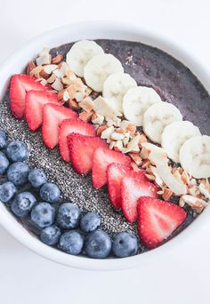 vegan berry green smoothie bowls with fruit and granola