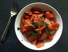 Alton Brown's Glazed Carrots: When it comes to pairing carrots with other flavors, I like keeping it in the same botanical family. By seasoning carrots with, say, fresh parsley, not only can we build a portfolio of contrasting flavors, the intensify the carrot flavor itself is amplified…that's right…to 11!