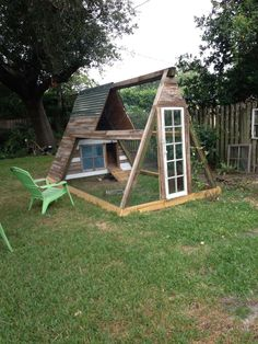 chicken coop made out of swing set | Coop made from old swing set. Used reclaimed wood from old fence ...