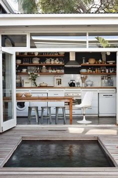 indoor/outdoor kitchen Include windows above up to ceiling height. Dark wall, 2 shelves