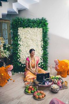 South Indian bride. Gold Indian bridal jewelry.Temple jewelry. Jhumkis.Pink silk kanchipuram sari.Braid with fresh flowers. Tamil bride. Telugu bride. Kannada bride. Hindu bride. Malayalee bride.Kerala bride.South Indian wedding.