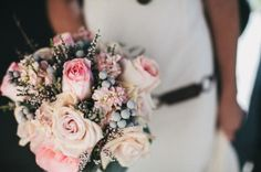 Pink roses and pale blue berries wedding bouquet // photo by Just Alex Photography