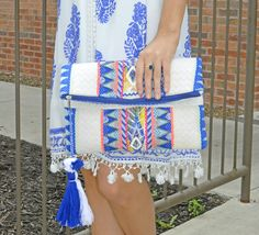 Make A Splash Clutch It's Beaded And Beautiful! Add The Perfect Accessory With This Royal Blue/Ivory Clutch With Neon Pink Detailing It Even Has A Sassy Multi Tassel, Could It Be Any Better?