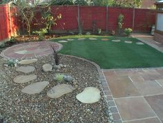 This is a low maintenance garden with only small lawn to maintain.  Never thought of putting stepping stones on gravel.