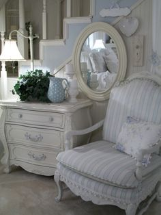 Love this vignette with the soft blue and white  Side table is gorgeous.