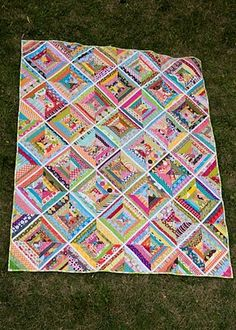 I love how the white strips totally rein in the chaos of this scrappy quilt!