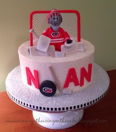 """When it comes to goaltending, Cam Ward usually says """"No""""... but when it comes to cake, he says """"Yes!"""" Here he is, in a sweet butterfly..."""