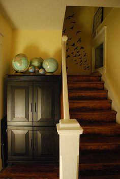 Globe collection and birds going up the stairwell...