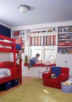 Boy Bedroom: Bunked beds in a child's play room can be great for siblings or for an only child to have sleep overs. The storage along the wall is great and the added seat on the window gives a cozy reading spot.