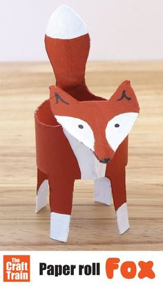 Easy paper roll fox craft for kids with free printable template. Flatten roll, trace shape, cut out, pop into a cylinder again and decorate to look like a fox. A fun woodland animal craft for kids to make in Autumn or Fall and a great recycling craft. #kidscrafts #woodlandanimals #foxcraft #autumn #fall #recyclingcraft #funkidscrafts #craftsforkids #animalcrafts #cardboard #diytoy #fox #thecrafttrain