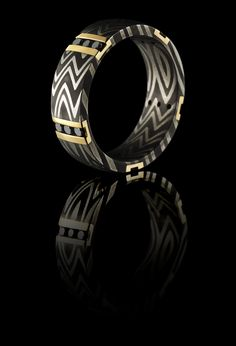 JCK  Jewelers Choice Award Winner 2015. This ring is so unique. Damascus, 14K gold and black diamond.