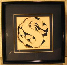 """Three Dimensional Paper Sculpture, Signed Original Art Work by D'Bishop of San Marcos, CA. Actual measurements of the frame are 8.25"""" x 8.25"""". Art work size is 4.25"""" x 4.25""""."""