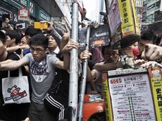 Protesting on the Streets of Hong Kong - The New Yorker  Pro-democracy protestors hold down their barricade as pro-Beijing demonstrators try to remove it during a tense exchange in Mong Kok on Saturday.