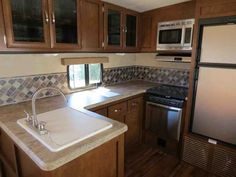 2016 New Forest River Vibe 268rks Travel Trailer in Oregon OR.Recreational Vehicle, rv, 2016 Forest River Vibe 268rks, Accessories: BROOKLYN INTERIOR DECOR,E-Z LUBE AXLES,SELF ADJUSTING BRAKES,ONE TOUCH ELECTRIC AWNGING,FULL EXTENSION BALL BEARING DRAWER GUIDES,STAINLESS STEEL KITCHEN PKG,POT AND PAN DRAWER UNDER DINETTE SEATS,2 OUTSIDE SPEAKERS,XL GRAB HANDLE,COACH-NET ROADSIDE ASSISTANCE,RADIAL TIRES,HEATED AND ENCLOSED UNDERBELLY,STAB JACKS,AERODYNAMIC PAINTED FIBERGLASS FRONT CAP,SINK…