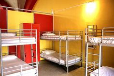 Shared bedrooms in Home Backpackers Hostel in a colourful and nice rooms!!!!