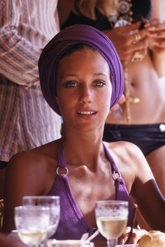 """FASHION ICON: MARISA BERENSON Berenson's über-chic grandmother often disapproved of her getups as the decade's nonconformist frocks—and headgear—took hold of her wardrobe. """"I was wearing the shortest miniskirts, a bohemian-hippie look, lots of transparent clothes. She was horrified,"""" Marisa recalls. How could anyone be mad at a face like this?"""