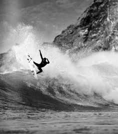 black-and-white surfer strikes a power pose