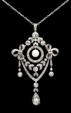 Diamond and Pearl Brooch/Pendant, probably yellow gold and platinum with a 16 14kt. white gold chain. Largest stone approx. 3/4 carat, 21/2 long x 1 3/4 wide