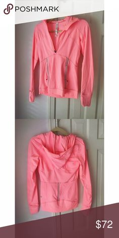 """Lululemon Pink Pullover Jacket I have never worn this it is in brand new condition! It is a pretty bright pink workout pullover jacket with two front pockets, a quarter length zipper, thumbholes, holes for earbuds and phone, and a hole in the hood for a ponytail. It is super comfortable and fitted, great for wearing over a tank for a run or post yoga. Color is """"bleached coral"""" lululemon athletica Jackets & Coats"""