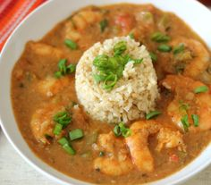Shrimp Etouffee - A thick, hearty shrimp dish tomato-based sauce, with green bell peppers and aromatic vegetables. and served with rice.