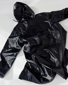 This is the Black Shiny Jacket by stunning brand Rains. This jacket is a tailored raincoat made from a waterproof and lightweight fabric with a matte, smooth appearance. Coat has a classic, yet casual silhouette, a drawstring hood with a built-in cap and side welt pockets. It is completed with adjustable cuffs and ventilation airholes for enhanced comfort. Rubber Rain Jacket, Waterproof Rain Jacket, Rainy Weather, Rain Wear, Danish Design, Get Dressed, Parka, Unisex, Parkas
