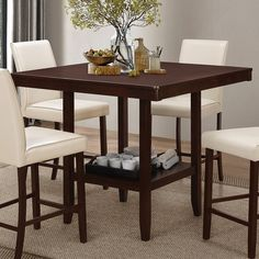 Completed with an espresso finish, this counter height table brings unique design to your dining setting. Transitionally-styled and able to fit within your dining room or kitchen, the table provides a more versatile setting than more traditional dining room tables. With a bottom shelf design, this table will provide storage and serve your dining needs.