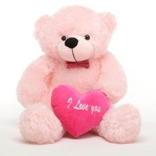 "Lady Cuddles LOVES love! She can sweep your sweetheart off his or her feet anytime with her pretty pink bear-ness and her ""I love you"" plush heart pillow!"