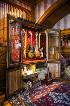 THIS is the way to store guitars. Not only does the GUITARMOIRE store and display your guitars, but it opens to a full pull out whiskey bar, gear storage and has room for a classic amp. Home Studio, Music Studio Room, Guitar Storage, Home Music Rooms, Paul Design, Guitar Cabinet, Reclaimed Furniture, Refinished Furniture, Pipe Furniture