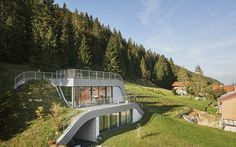 Swooping French Home Is Partially Built Into a Hillside - Globe Trotting - Curbed