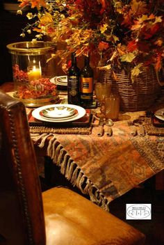When you're decorating your Thanksgiving table, try using a throw blanket for a table topper, like we did at Nell Hill's.