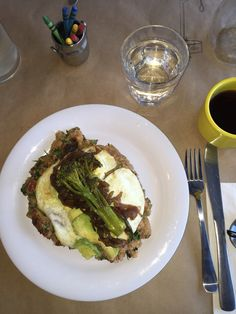 Quinoa with roasted tomatoes, topped with two fried eggs, avocado, caramelized onion and broccolini  healthy, gluten free, delicious. From Simple Things in Los Angeles.