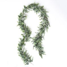 Trending artificial wedding greenery garlands like this gorgeous green eucalyptus garland. Dress up this luscious euc garland with silk flowers to use as a floral table runner. Perfect to accent chair