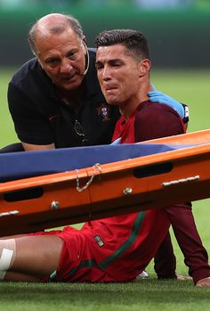 #EURO2016 Cristiano Ronaldo of Portugal reacts to an injury during the UEFA Euro 2016 Final match between Portugal and France at Stade de France on July 10...