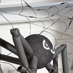 DIY Halloween Decoration: Spider Web. Great for decorating the outside of your house this Halloween!